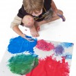Stock Photo: High angle view of a boy doing painting