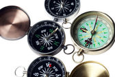 Cropped image of three compass — Stock Photo