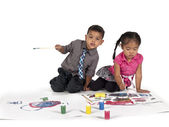 Playful little asian kids painting — Stock Photo