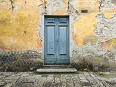 Closed door of a old house — Stock Photo