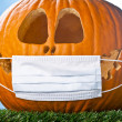 Stock Photo: Jack o lantern with covered mouth
