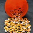 Stock Photo: Variety of candies spilled out of the bucket
