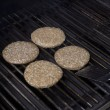 Foto Stock: Grilling hamburger patties