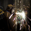 Stock Photo: View of welder cutting metal