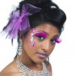 Portrait shot of a young beautiful female wearing stage make up — Stock Photo #18819745