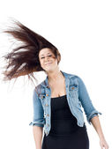 Woman tossing her hair — Stock Photo
