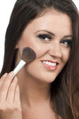 Young woman applying blusher — Стоковое фото