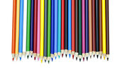 View of colored pencil arranged orderly over white background — Stock Photo