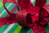Close up shot of shiny red ribbon — Foto de Stock
