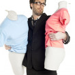 Male fashion designer holding two dummies — Stock Photo