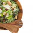 Wooden bowl with salad and salad mixer — Stock Photo