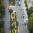 Elevated view of road with cars and trees -  