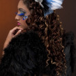 Rear view of a young woman wearing fur coat and stage make up — Stock Photo