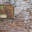 Stock Photo: Brick wall with wooden window