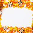 Image of arranged candy corns and pumpkins — Stock Photo