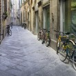 Tuscan streets with bikes - Stock Photo