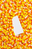 Candy corns with placard — Stock Photo