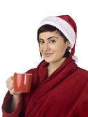 Santa woman holding a glass of coffee — Stock Photo