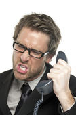 A stressed businessman answering call — Stock Photo