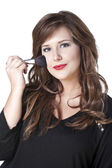 Woman with make up brush — Stock Photo