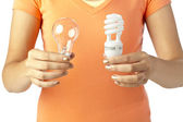 Human hand holding two different kinds of light bulbs — Stock Photo