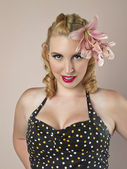 Gorgeous female model with flower on her head — Stock Photo