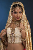 Gorgeous indian bride looking at camera and smiling — Stock Photo