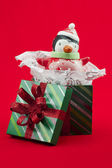Close up image of gift box with snowman toy — Foto de Stock