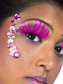 Cropped shot of a young female wearing make up and false eyelash — Stock Photo