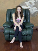 Teen girl on chair — Stock Photo
