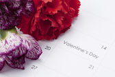 Flowers on calender showing valentines day — Stock Photo