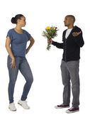 Man pleasing his girlfriend with flowers — Stock Photo