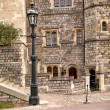 Stone building and lamp post — Stock Photo