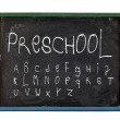 Alphabet and preschool written on slate board — Stock Photo
