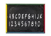 Las letras del alfabeto y los números escritos en pizarra pizarra — Foto de Stock