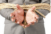 Businessman hands tied up with rope — Stock Photo