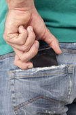 Cell phone on the back pocket — Stock Photo