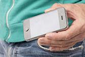Human hand holding mobile phone — ストック写真