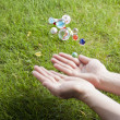 Throwing assorted marbles — Stock Photo