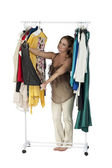 Woman selecting clothes — Stock Photo