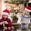 Brother and sister making gingerbread house — Stock Photo