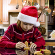 Cute boy making gingerbread house — Stock Photo