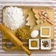 Stock Photo: Overhead view of cake ingredient on kitchen worktop with rolling