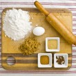 Top view of cake ingredient and rolling pin on kitchen worktop — Stock Photo #19349965