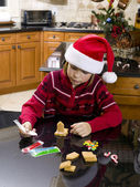Boy making gingerbread house — Stock Photo