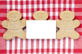 Close up image of empty placard and gingerbread candies — Stock Photo