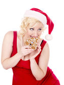 Close up of woman eating a cookie — Stock Photo