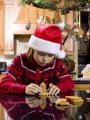 Cute boy making gingerbread house — Stock Photo