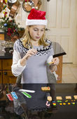 Girl building gingerbread house — Stock Photo