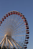 Low angle view of ferris wheel against blue sky — Stock Photo